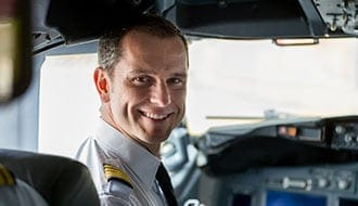 Smiling pilot in a cockpit