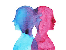 Two heads facing apart in watercolour