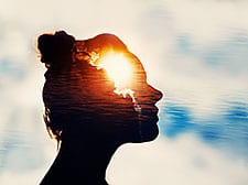 silhouette of woman's head against the sky
